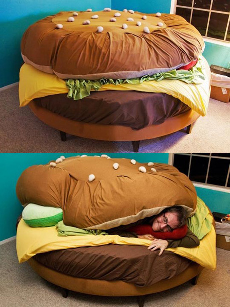 This eyes-watering Burger bed is crazy! I like it but I have doubt if it's  comfortable. The man lying is so covered and I wonder if it's too warm and  heavy.